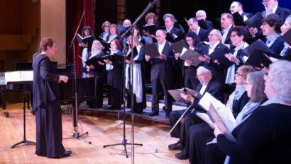 Adult choir singing on stage.