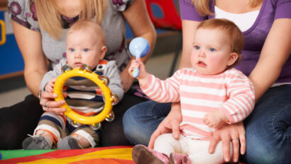 Babies playing with toy instruments.