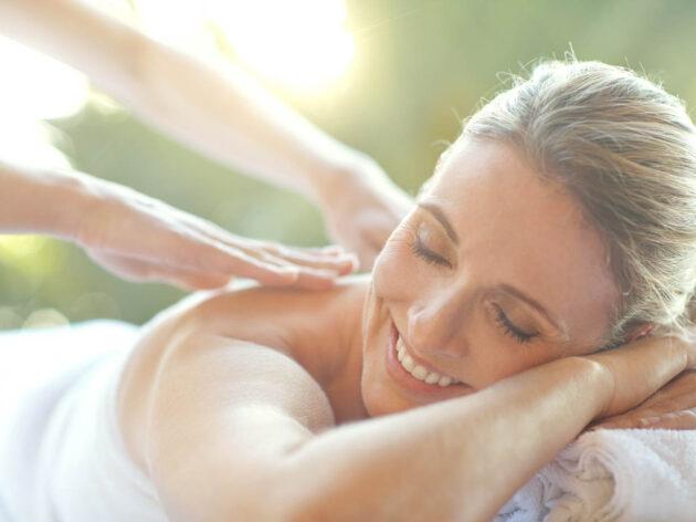 Woman getting a back massage.