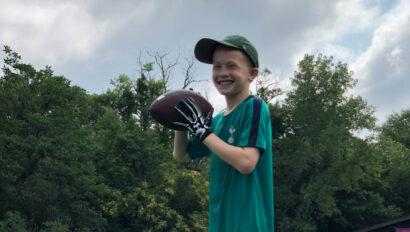 Boy holding a football.