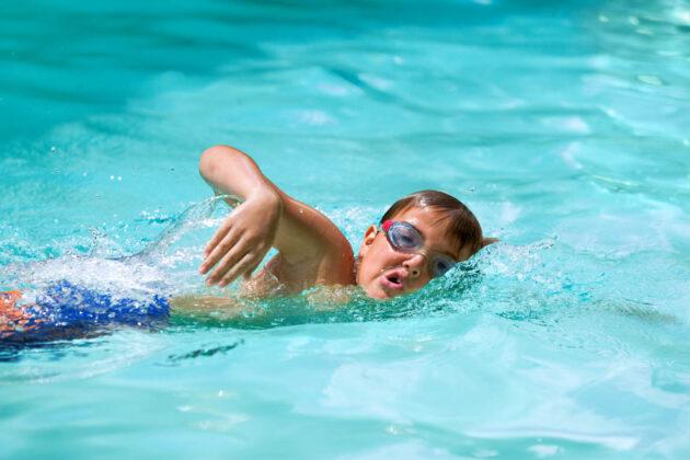 Boy swimming the breast stroke.