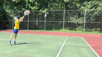 Boy playing tennis.