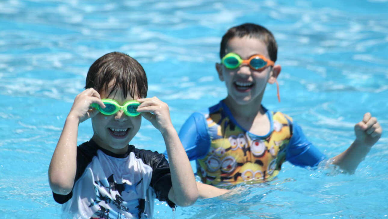 Boys with goggles in the pool.