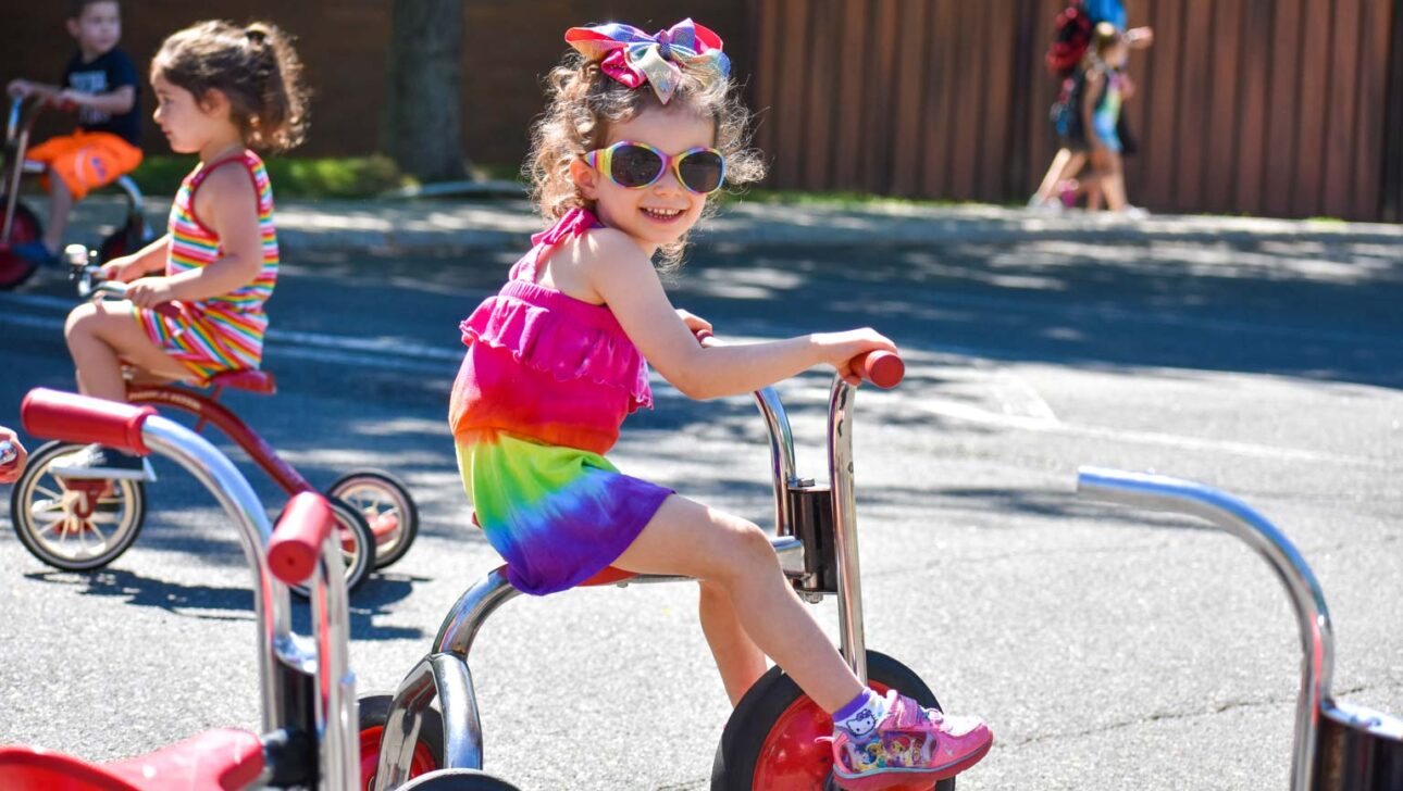 Girl on a tricycle.