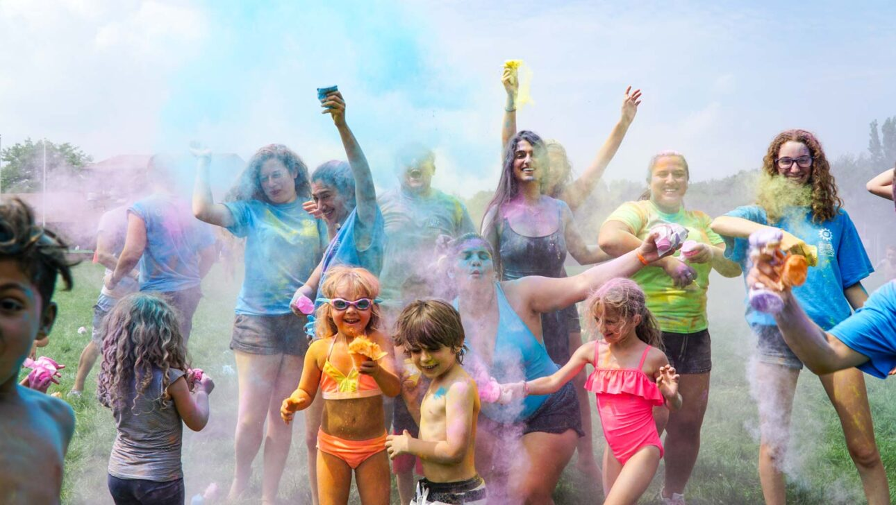 children playing and throwing colorful powder.