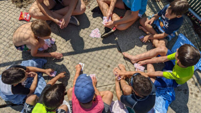 Kids playing a card game.