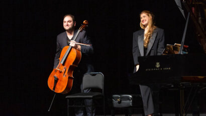 Cellist and pianist bowing on stage.