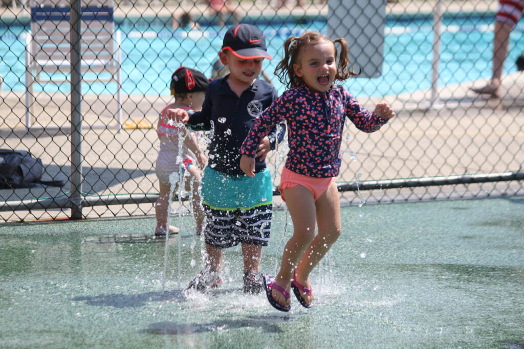 Children playing in a water park.