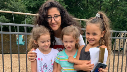 Counselor with three girl campers.