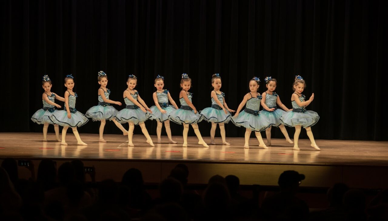 Girls performing on stage.