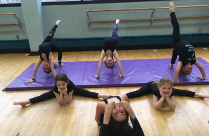 Girls stretching in dance class.