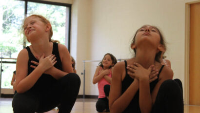 Girls doing a dramatic dance pose.
