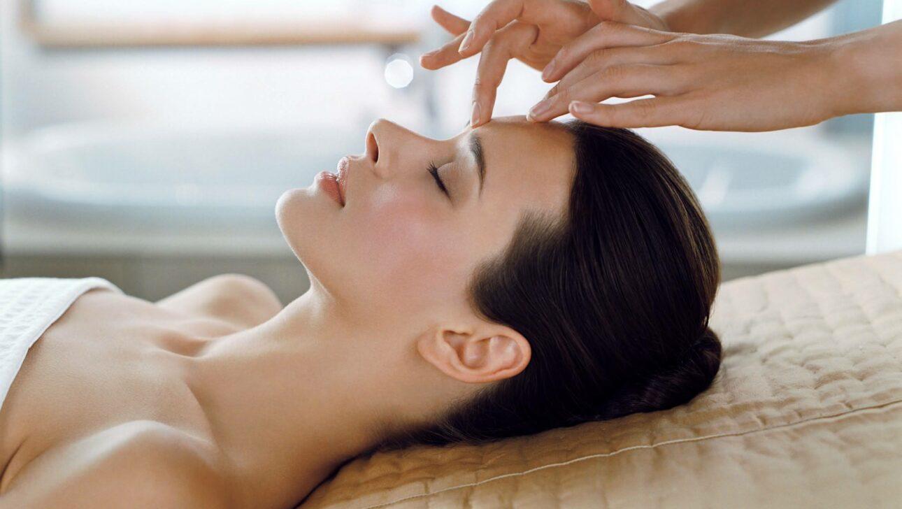 Women receiving a head massage.