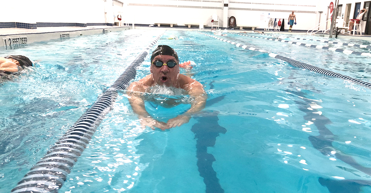 Swimmer doing the breast stroke in the indoor pool.