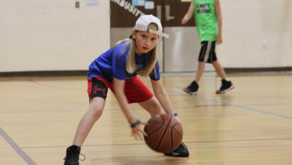 Girl playing basketball.