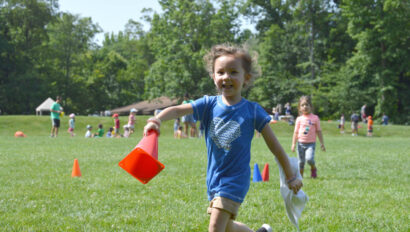Girl running with a cone.