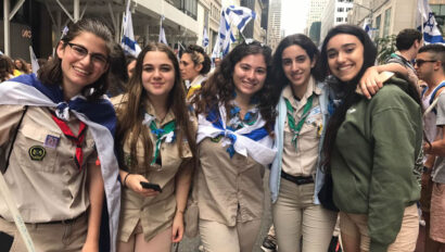 Group photo of girls in scout uniforms.
