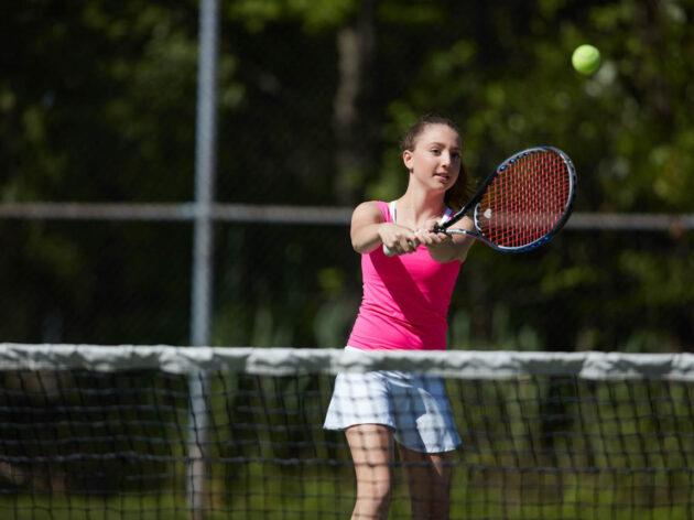 Girl playing tennis.
