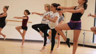 Girls practicing a ballet routine.