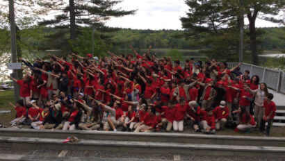 Huge group photo of all scouts in red shirts.