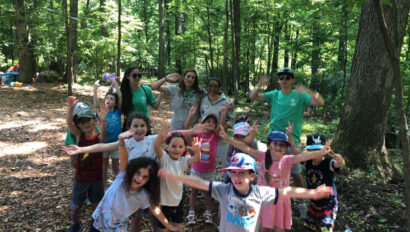 Group of kids on a walk in the woods.