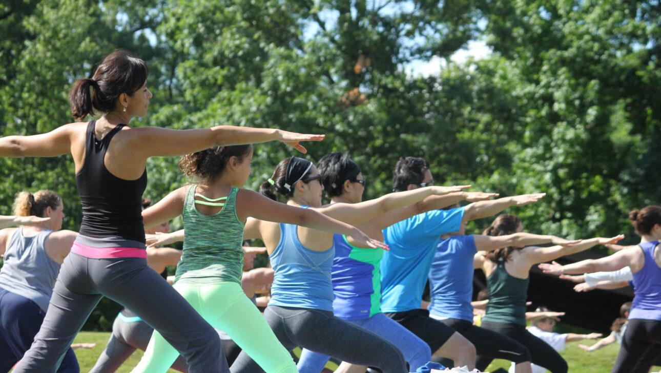 Group yoga class outside.
