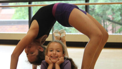 One girl doing a human bridge over another girl.