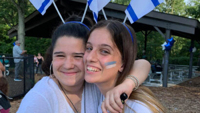 Two women with Israeli flags in their hair.
