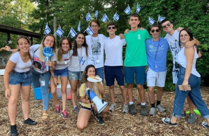 Group of counselors with Israeli flags in their hair.