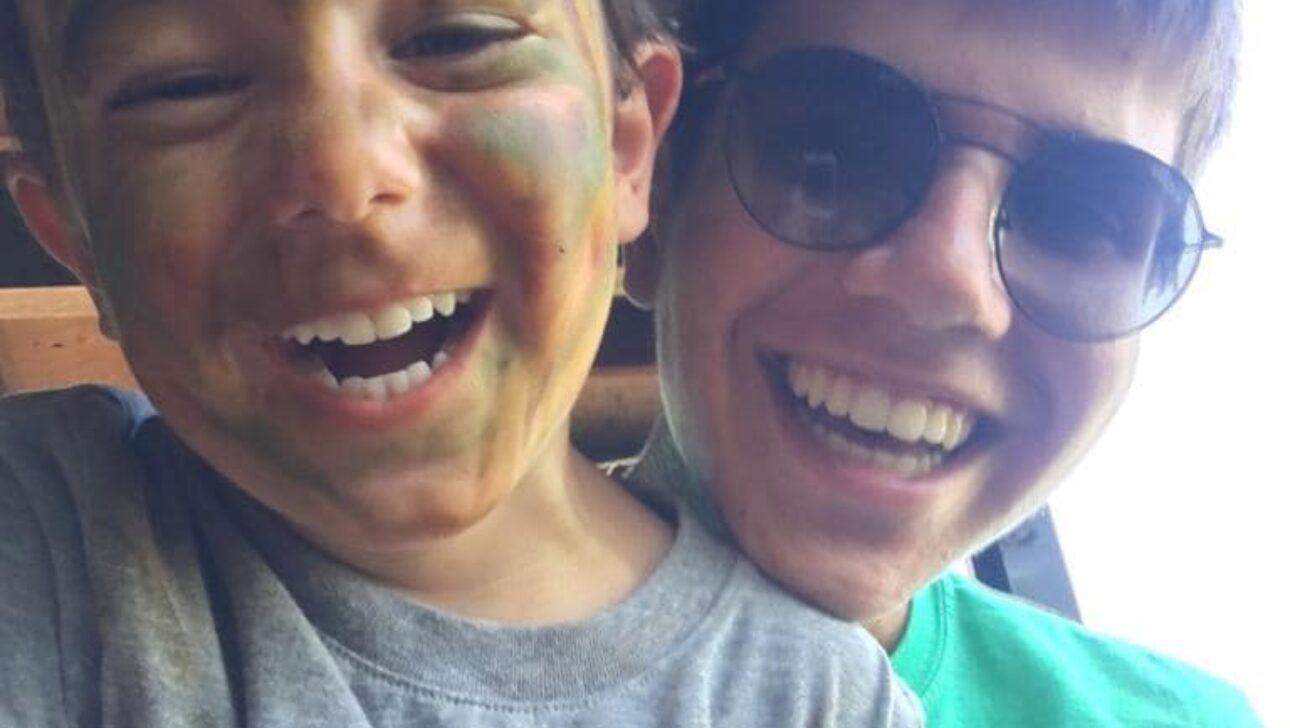 Children smiling in a selfie.