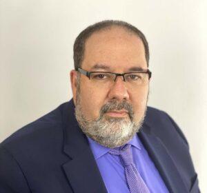 Portrait photo of Jordan in a suit