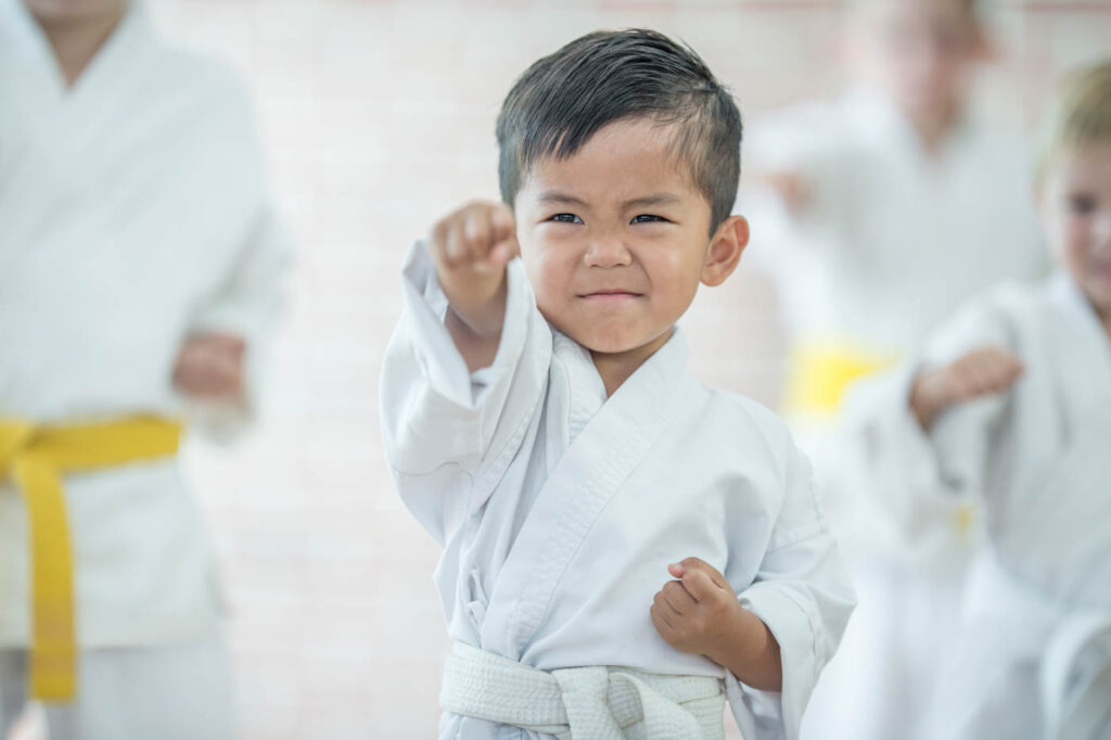 Young boy in a martial arts robe.