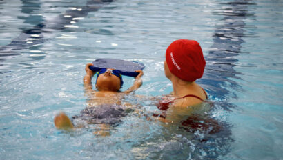 Child and swim instructor during a swim lesson.