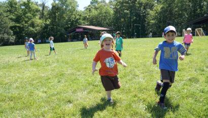 Kids running in a field.