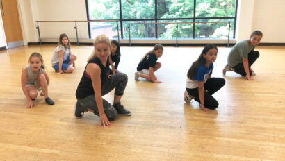 Girls practicing a dance routine.