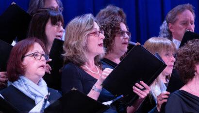 Women in adult choir singing.
