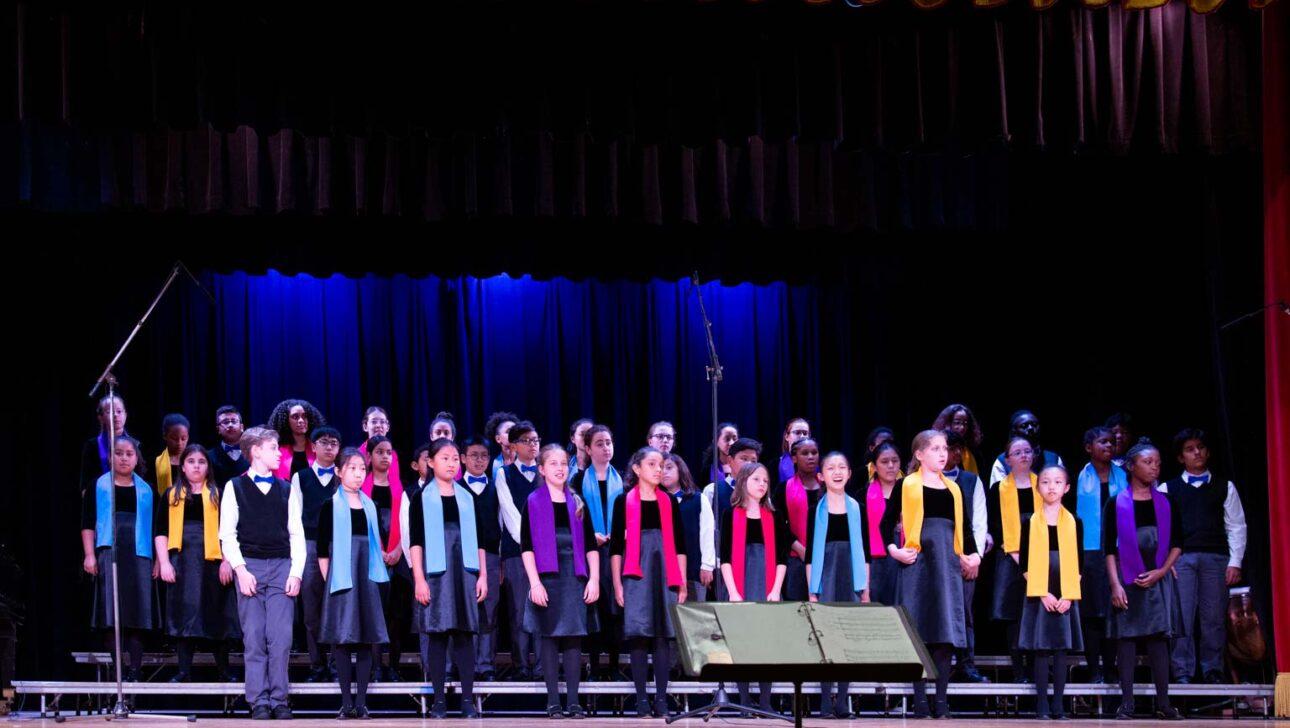 Chorus performing on stage.