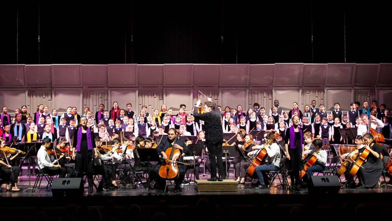 Orchestra and chorus performing on stage.