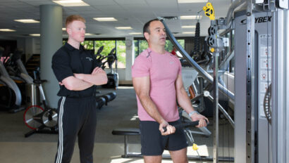Man being trained by a personal trainer.