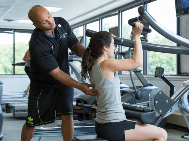 Woman being trained by a personal trainer.