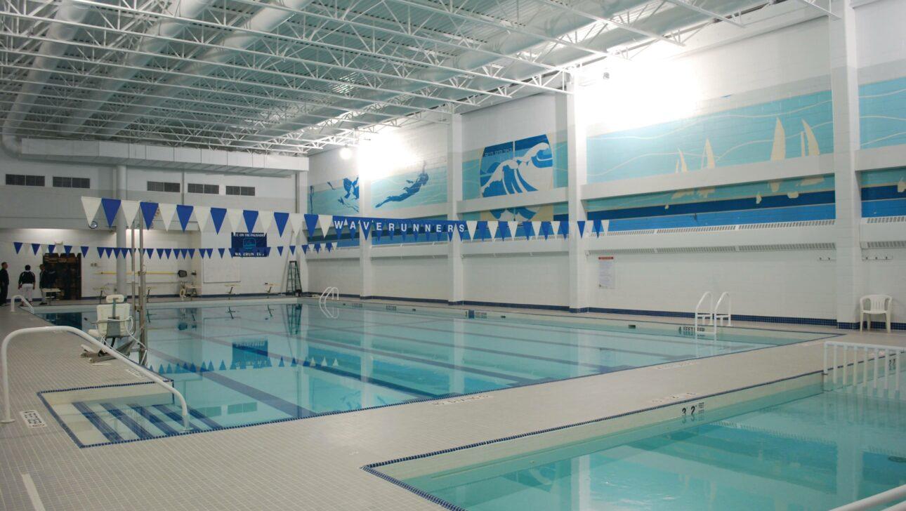 Indoor empty pool lanes.