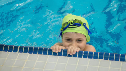 Boy smiling in the pool.