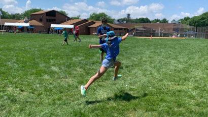 Camper running on a field.