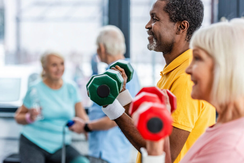 Seniors in a weight exercise class.