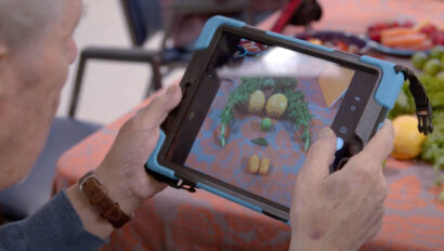 Senior playing a game on an ipad.