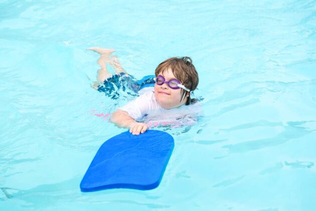 Adult with special needs swimming.