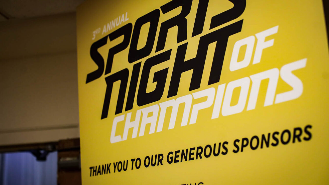 Sports Night of Champions sign.