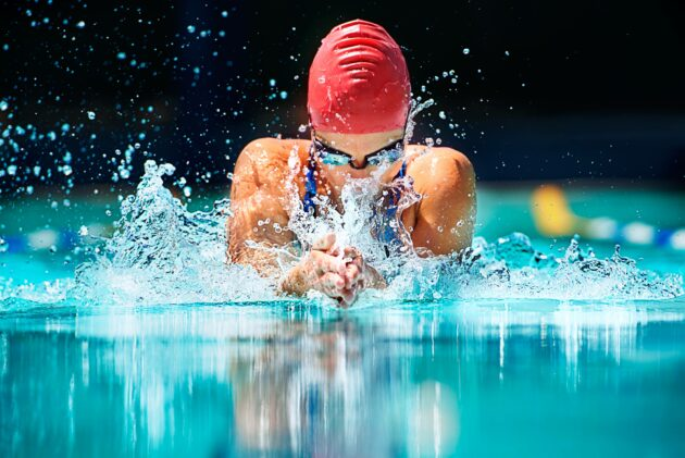 Shot of a young female swimmer doing the butterfly stroke