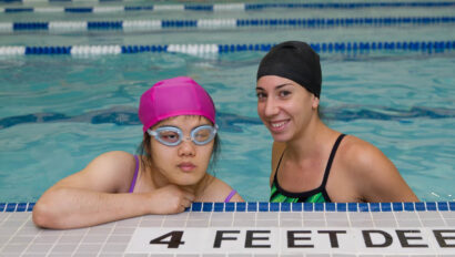 Swim instructor and student in the pool.
