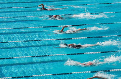 Swimmers swimming laps in a race.